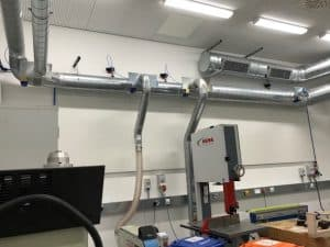 Energy efficient dust extraction system for UCl